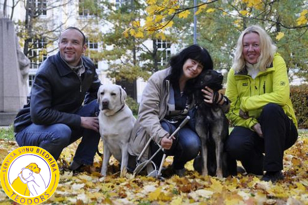 The Latvian team in the guide dog competition in Tartu October. From the left Aleksejs with Teodors, Natalija with Lati and dog trainer Zaiga