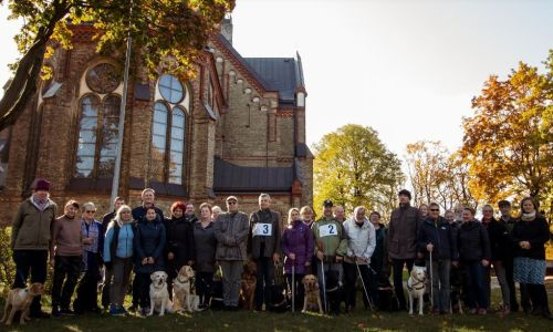 All participants and assistants in the beautiful Torņakalns Church Park.